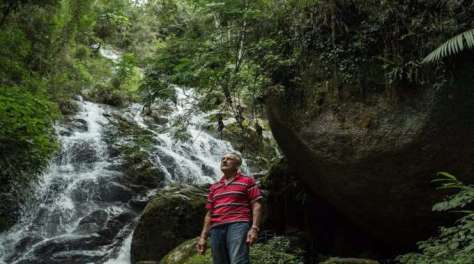 antonio-vincente-by-his-forest-waterfalls